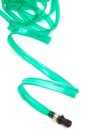 green hose on a white background Stock Photo