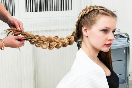 haircutting: weave braid girl in a hair salon Stock Photo
