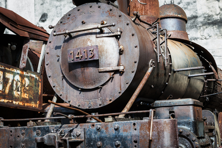 railway history: old steam locomotive on the background wall