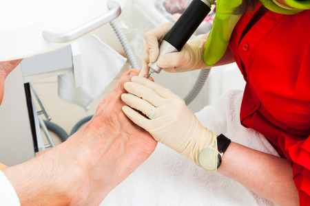 chiropodist: pedicures man in modern beauty salon Stock Photo