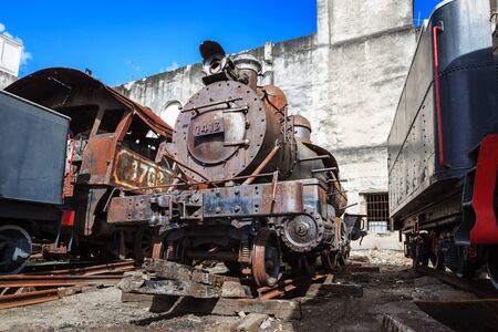 steam locomotives: old steam locomotives on wall background Stock Photo