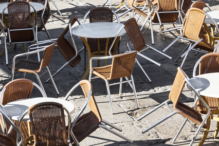 tables and armchairs in a cafe on the street photo