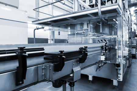 conveyor working at a modern plant Archivio Fotografico