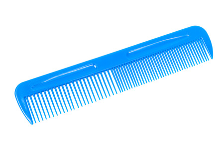 blue plastic comb on a white background Foto de archivo