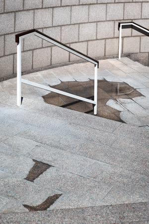 bannister: rain puddle on the stairs