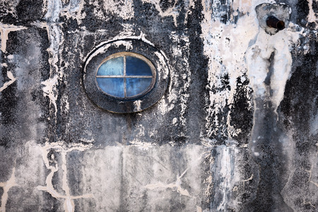oval window on the old wall photo