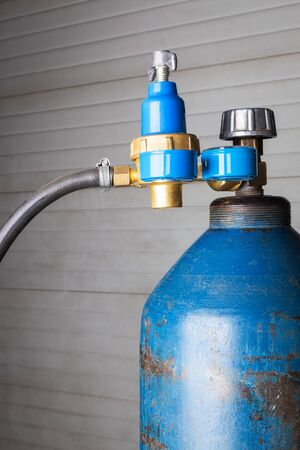 compressed air hose: blue gas cylinder close up Stock Photo