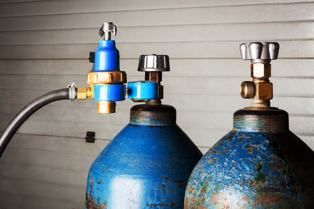 compressed air hose: blue oxygen cylinders close up