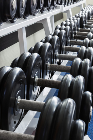 sports club: dumbbell on a stand in a sports club