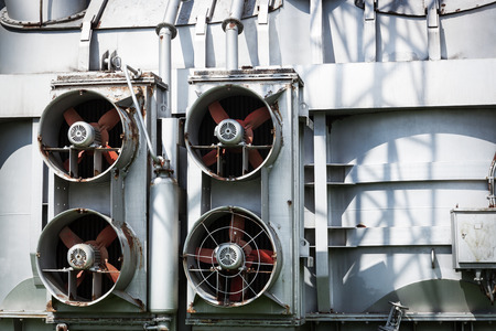 engines: fans outdoors on a metal wall Stock Photo