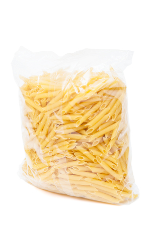 cellophane: macaroni in the package on a white background Stock Photo