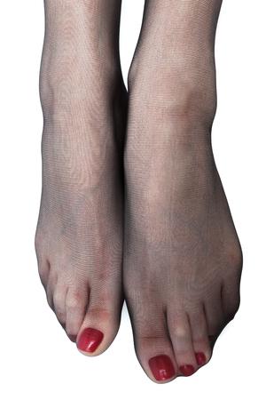 白い背景の上でストッキング女性の足