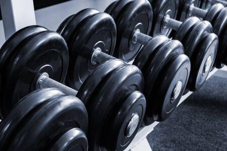 sports club: Heavy sports dumbbells in modern sports club
