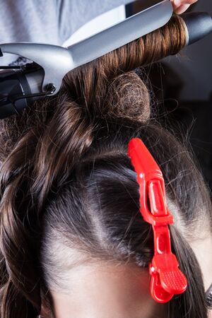hairdressing salon: manufacturing hairstyle curling in a hairdressing salon