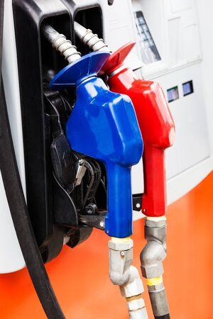 hoses: two gas hoses on a modern gas station Stock Photo