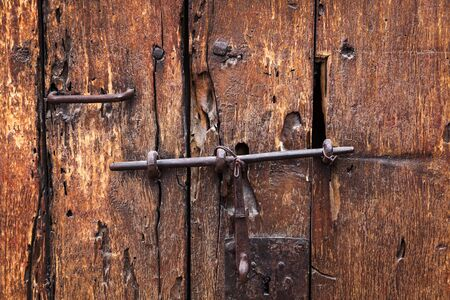 iron nail: heck and lock on an old door Stock Photo