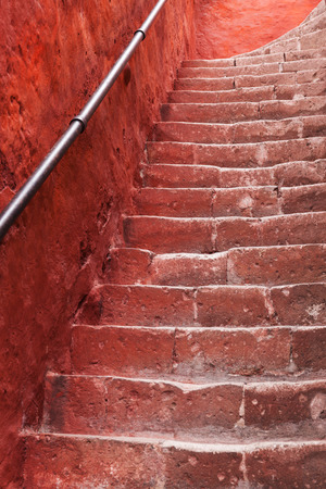 bannister: beautiful old staircase and red wall Stock Photo