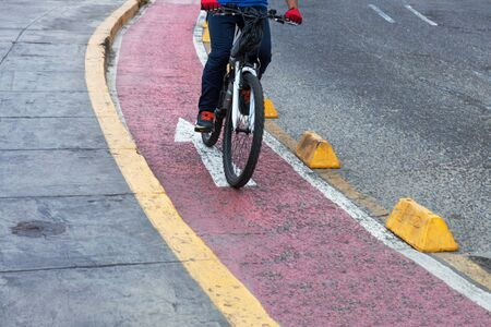 single lane road: bicyclist red bike path in the modern city