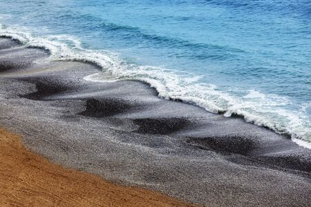 lima: waves on pebble beach in Lima Peru