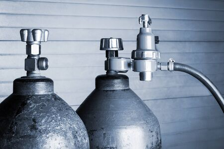 gas cylinder: two blue oxygen cylinders close up Stock Photo