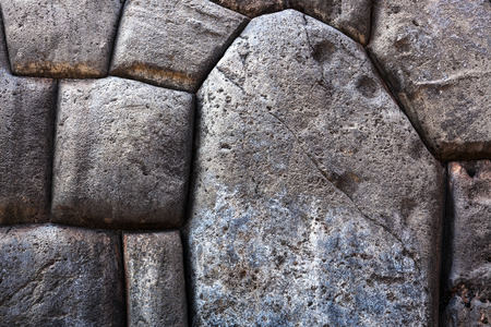 masonry: polygonal stone in an old masonry of the Incas