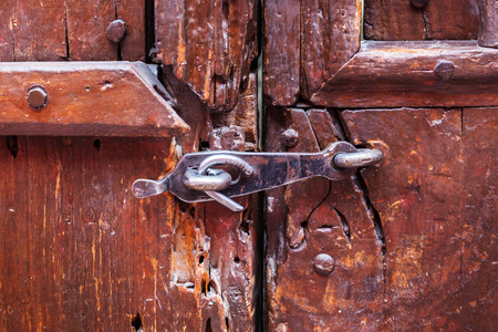 locked up: old wooden door locked on the latch Stock Photo