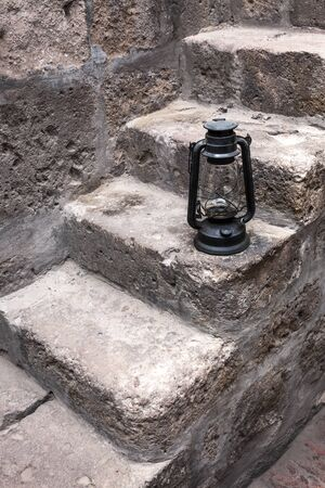 kerosene lamp: kerosene lamp in a beautiful old staircase