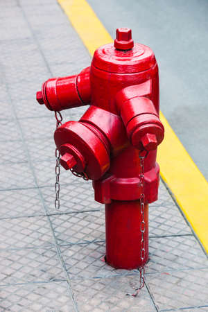fire hydrant: red fire hydrant on a city street