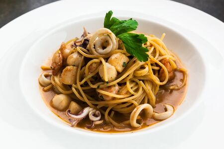 quid: lunch with seafood and pasta Stock Photo