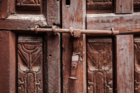 locked: old wooden door locked on the latch Stock Photo