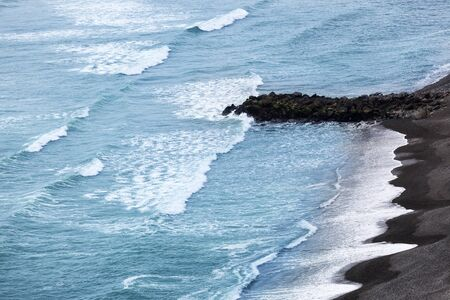 miraflores: waves on pebble beach in Lima Peru