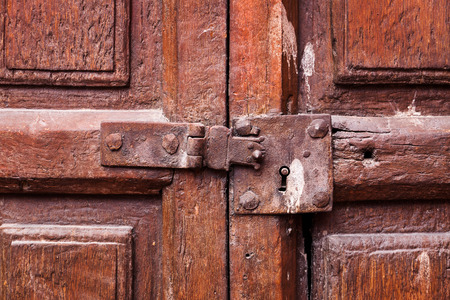 latch: wooden door with a keyhole and latch