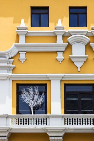 house windows: yellow house with a large balcony windows