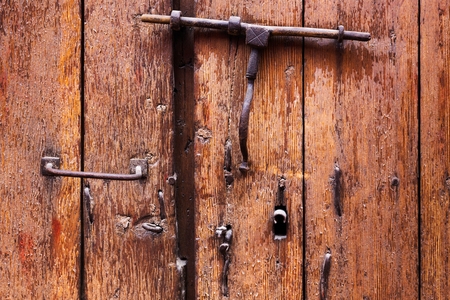 keyhole and a heck of wooden door Stock Photo