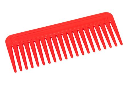 plastic comb: red plastic comb on a white background Stock Photo