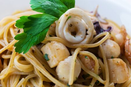 quid: tasty lunch with seafood and pasta Stock Photo
