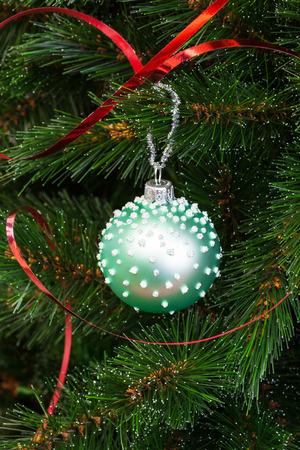 christmas tree ball: beautiful green ball on the Christmas tree
