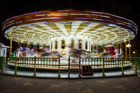 antique booth: beautiful bright carousel at black night Stock Photo