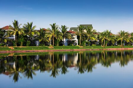 coconut trees: Beautiful villas on the shore of the lake