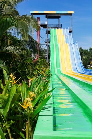 water slides in tropical aqua park Stock Photo