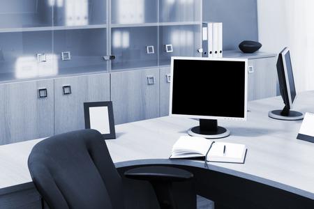 monitors on a desks in modern office