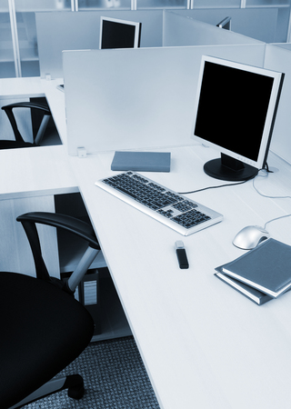computers on the desks in modern office