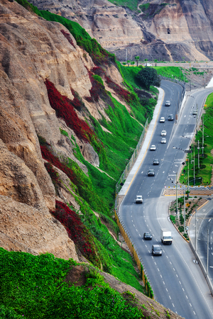 road with cars off a cliff, Lima, Peru