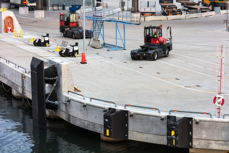 modern cargo port with new forklifts