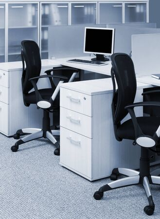 desks and chairs in a modern office