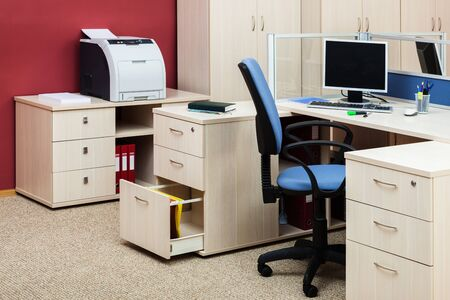 office workplace with computer and printer