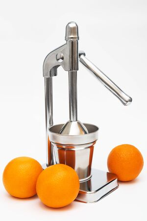 juicer with oranges on a white background Archivio Fotografico