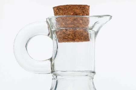 glass jar and cork on a white background Фото со стока