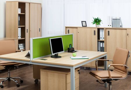 comfortable workplaces in a modern office Archivio Fotografico - 150192425