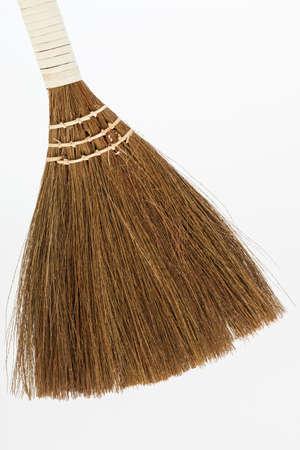 new broom on a white background Archivio Fotografico